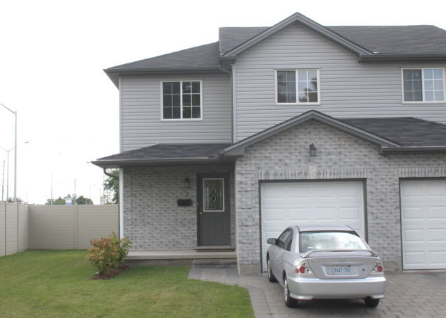 Royal Premier Homes - Eco Friendly Home Builders London - Aspen - House Front View with Car - Gallery Image