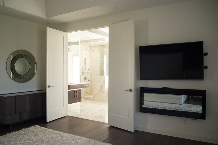 Royal Premier Homes - Eco Friendly Home Builders London - Cranbrook I - White Bedroom with Television and Bathroom