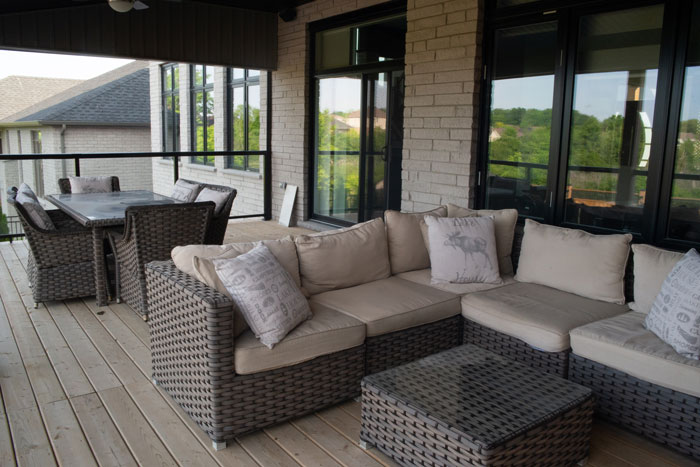 Royal Premier Homes - Eco Friendly Home Builders London - Cranbrook I - Balcony with Sofa and Tables