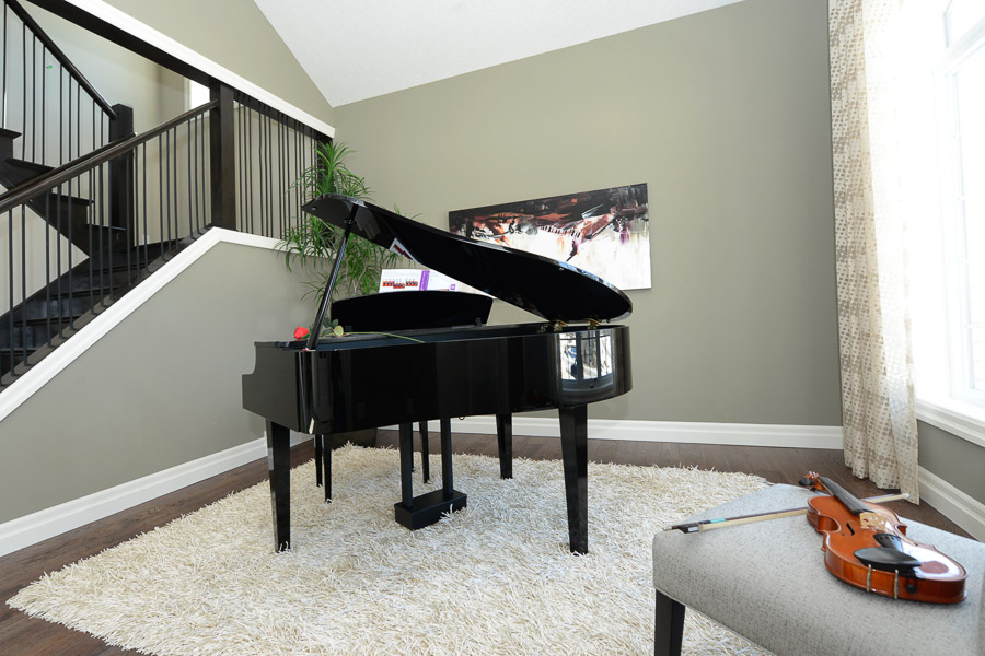 Royal Premier Homes - Eco Friendly Home Builders London - Cranbrook - Living Room with Piano and Violin
