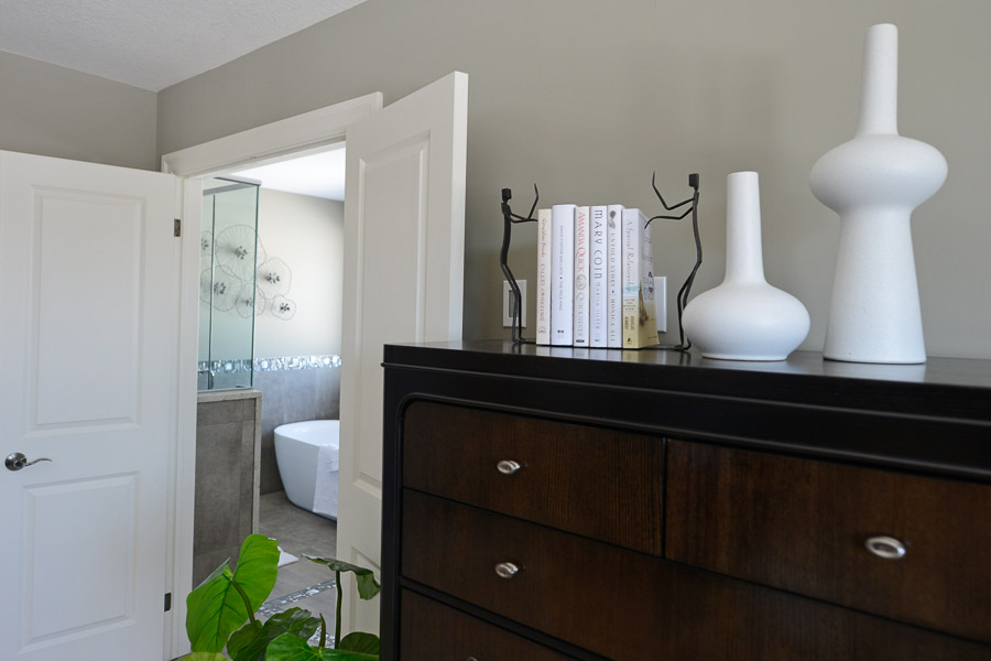 Royal Premier Homes - Eco Friendly Home Builders London - Cranbrook - Brown Cabinet with Books and Vase