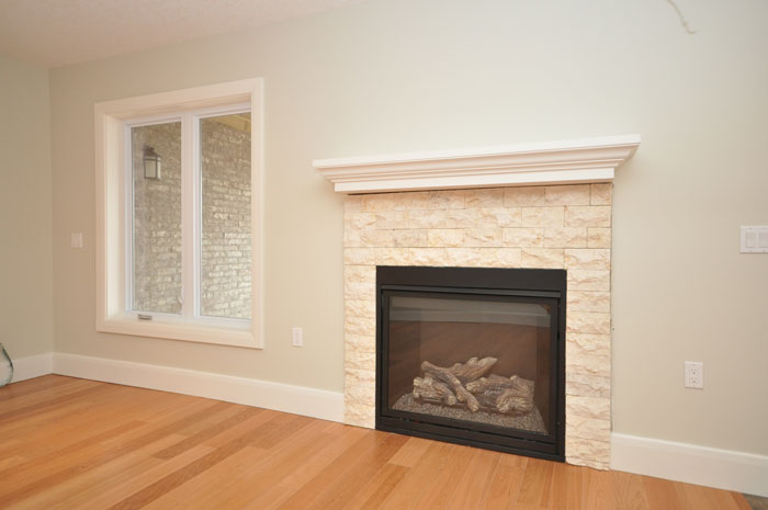 Royal Premier Homes - Eco Friendly Home Builders London - Crestwood II - Empty Room with Fireplace