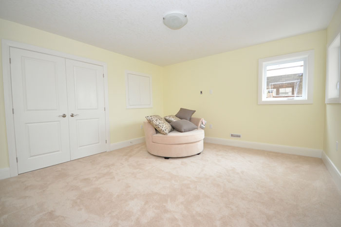 Royal Premier Homes - Eco Friendly Home Builders London - Crestwood II - Empty Room with Sofa